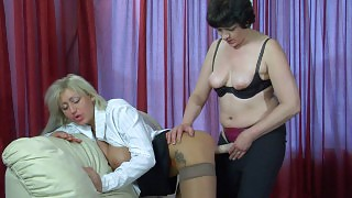 Horny milf gives her younger female co-worker some strap-on fucking options videos