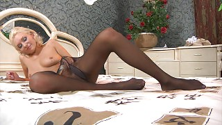 Blondie teases with her well-maintained feet and toying her pantyhosed pink videos