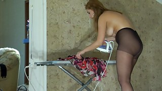 Hot beauty puts on black control top hose before ironing her summer dress videos