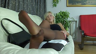Heated blondie massaging her yummy feet right through her suntan pantyhose videos