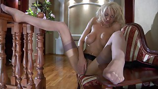 Busty blond dreamboat flashes her privates while putting on her fine nylons videos