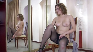 Curly-head tries on tights of different color enjoying their smooth feel videos