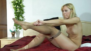 Freaky blonde babe changes into a new pair of hose and tears them to shreds videos