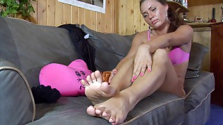 Doll-faced babe relaxing on her beloved sofa and massaging her nyloned feet videos