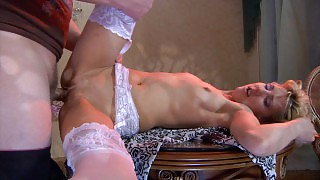 Eager guy attaches a gal\s white stockings to a garter before a hot quickie videos