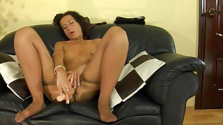 Sultry chick with lovely nyloned feet shoving a dildo up her burning hole videos