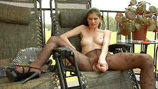 Beautifully dressed girl rams a big dildo thru her gorgeous fashion tights videos