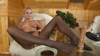 Lewd blonde in crotchless sheer hose going for foot sex with a rubber cock videos
