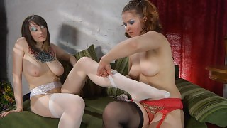 Hot lesbo changes her striped stockings to black ones before lesbian sex videos