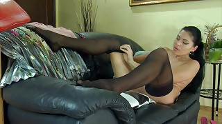 Dark-haired temptress enjoys the feel of her newly bought black stockings videos