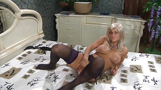 Dazzling temptress in luxury violet corset fits on her dark lacy stockings videos