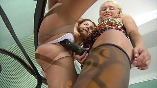Heated chick gets her lacy pantyhose broken after lesbian strap-on fucking videos