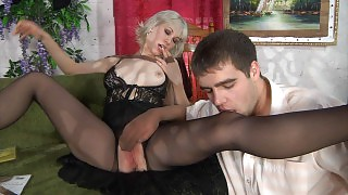 Heated blondie spreading her legs in black crotchless hose for hard boning videos