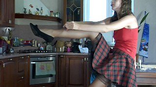 Tasty hottie changes into her tartan teen skirt and V-brief suntan tights videos