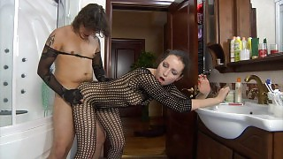 Teasing chick in a see-thru bodystocking luring her guy into pantyhose sex videos