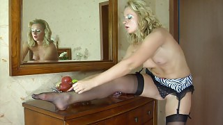 Heated blonde admiring the look of her black nylons and animal print garter videos