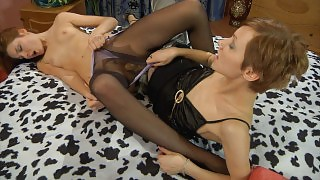 Lovely girl puts on black sheer-to-waist hose for role play with a strap-on videos
