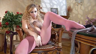Awesome chick pleasures her sleek pantyhosed slit with her nylon clad hands videos