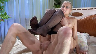 Footsie blonde in black fashion tights rides a cock after a steamy footjob videos