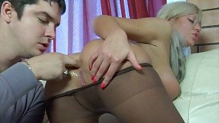 Sultry babe in tan control top hose lures a guy into hardcore butt balling videos