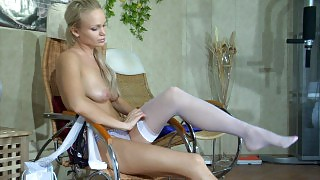 Seductive blondie changing out of her summer dress and sexy white stockings videos