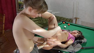 Vivacious lesbian chick mounts a billiard table for strap-on ass-fucking videos